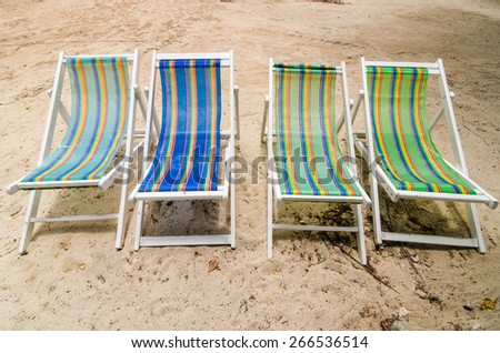 Beach colorful chair on the beach in Koh Samet Thailand - stock photo