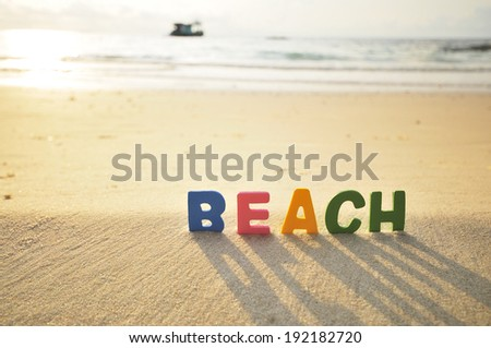 Beach, Colorful wooden text on the beach