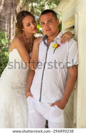 Beach couple walking on romantic travel honeymoon having fun. - stock photo