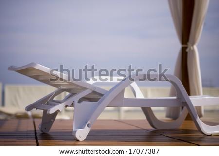 Beach deckchair - stock photo