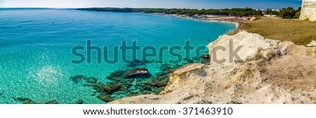 beach facilities on bay near rocky cove on the coast of Salento in Puglia in Italy - stock photo