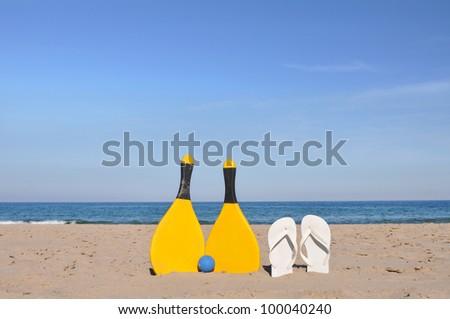 Beach Flip Flops Paddle Ball at Twilight - stock photo