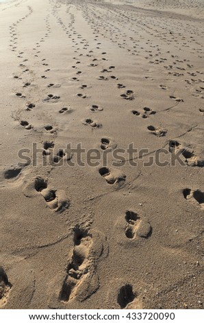 Beach footprint trails in Algarve, Portugal. Natural backgrounds and summer vacation destinations - stock photo