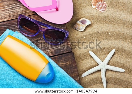 beach gear lie on the sand with shells - stock photo