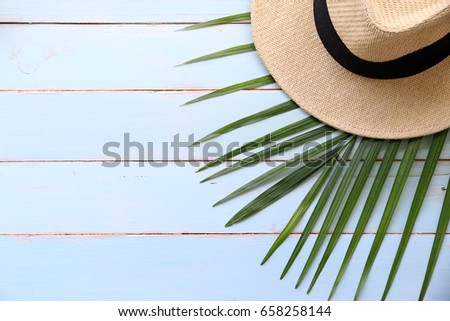 summer wooden table beach hat coconut leaves on wooden stock photo 658258144