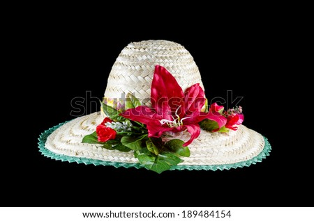beach hat and flower isolated on black with clipping path - stock photo
