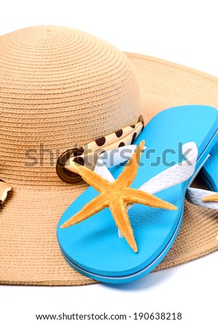 Beach hat, flip flops and starfish isolated on white - stock photo