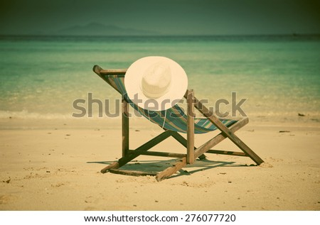 Beach hat on chair, Thailand - retro style postcard - stock photo