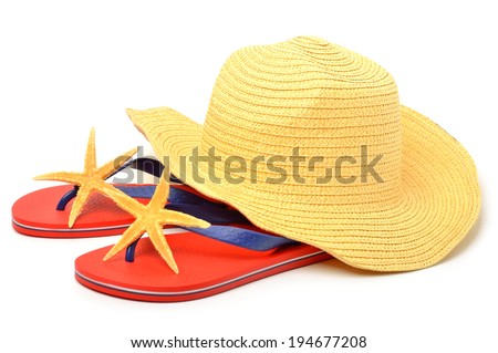 Beach hat, red flip flops with starfishes - stock photo