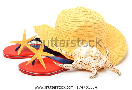 Beach hat, red flip flops with starfishes and a seashell isolated on white - stock photo
