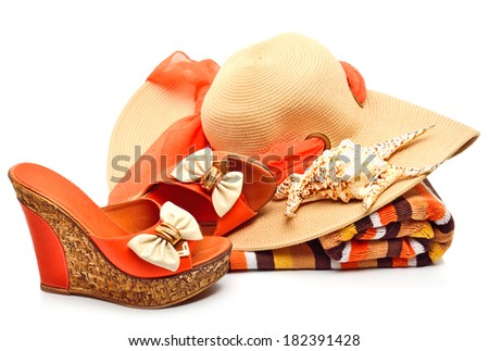 Beach hat, towel, stylish woman shoes and a seashell isolated on white - stock photo
