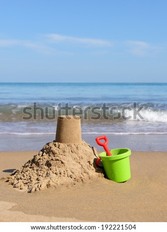 beach holiday sand castle by the sea hot summer fun - stock photo