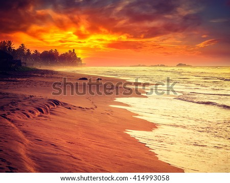 Beach holidays vacation romantic concept background - vintage retro effect filtered hipster style image of tropical sunset on ocean beach. Hikkaduwa,  Sri Lanka - stock photo