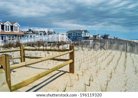 Beach homes along the coast in Surf City on Long Beach Island in New Jersey. - stock photo