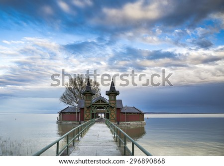 Beach house and long bridge on the lake Balaton, Keszthely, Hungary