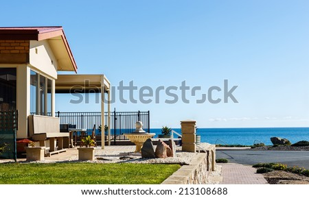 Beach house on seashore cost on a sunny day - stock photo