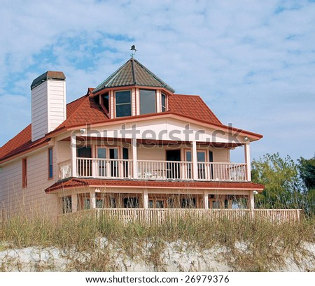 Beach house over looking the sand and water - stock photo
