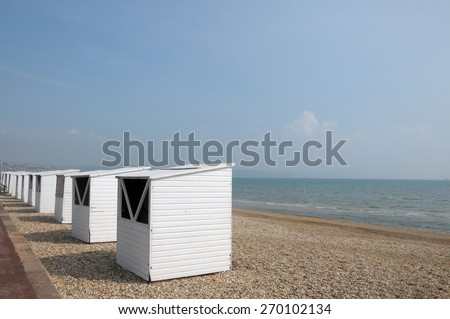 Beach huts along seafront, Weymouth, Dorset - stock photo