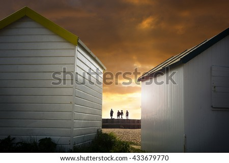 Beach huts and walkers