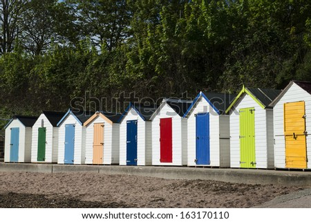 Beach Huts at Torquay, Sussex, UK. - stock photo