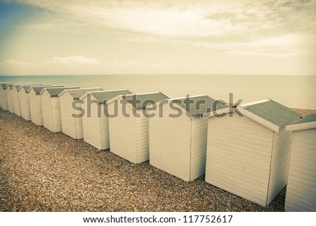 beach huts in seaside town bexhill on sea, east sussex England. small wood chalets on the coast