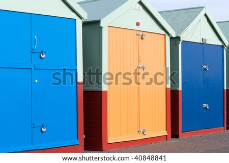 Beach huts on Brighton seafront England UK