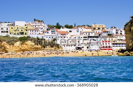 beach  in Carvoeiro town with colorful houses on coast of Portugal - stock photo