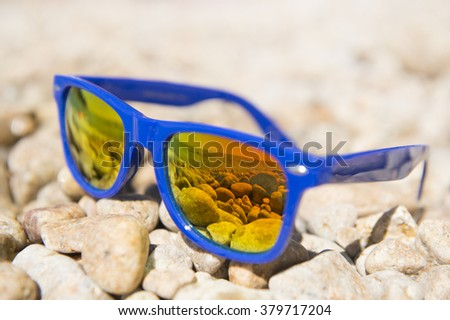 Beach landscape in sunglasses on vacation - stock photo