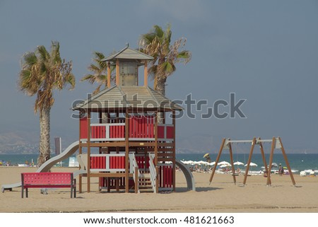 beach landscape with a toboggan house shaped