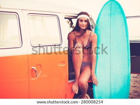 Beach Lifestyle, Beautiful Surfer Girl with Classic Vintage Surf Van on the Beach at Sunset  - stock photo