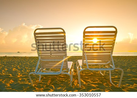 Beach lounge chairs in Miami Florida at sunrise