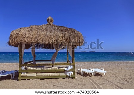 Beach lounge with the sea horizon view