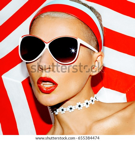 Beach model. Fashion sunglasses. Retro Red