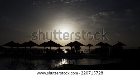 Beach of african hotel resot in the night, light manipulated - stock photo