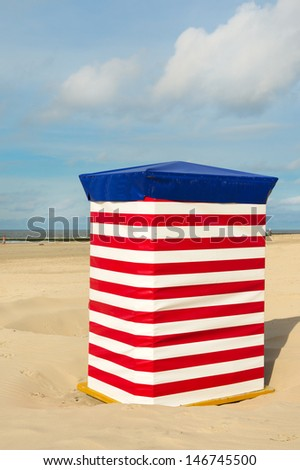 Beach of German wadden island Borkum with red and white striped chair