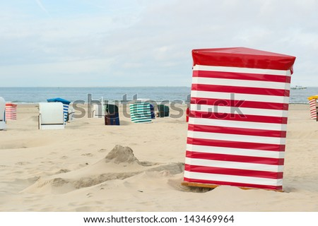 Beach of German wadden island with typical striped chairs