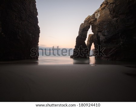 Beach of Las Catedrales or As Catedrais, Ribadeo, Galicia, Spain. The photo is taken at twilight - stock photo