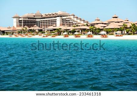 Beach of the luxury Thai style hotel on Palm Jumeirah man-made island, Dubai, UAE - stock photo