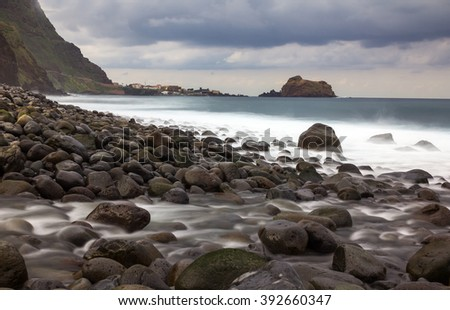 beach on Madeira island with rocks on a stormy day in winter