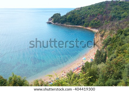 Beach on the Montenegrin coast, the bay in the Adriatic Sea, a top view - stock photo