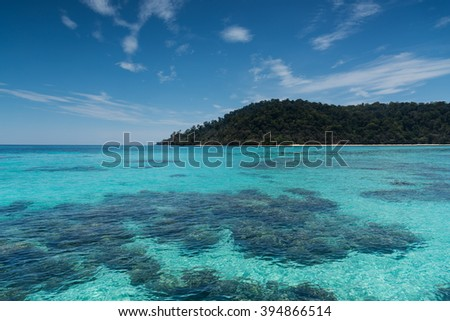 Beach on the tropical island with green water blue sky, koh rok of Thailand - stock photo