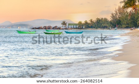 Beach panorama. Traditional wooden boats on sunset background - stock photo