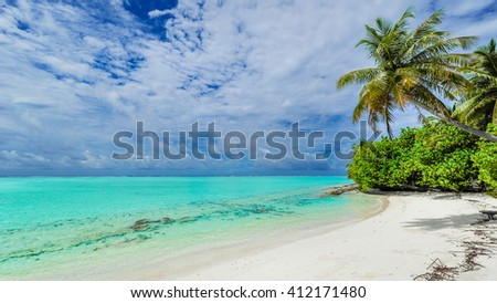 Beach paradise in Bora Bora - stock photo