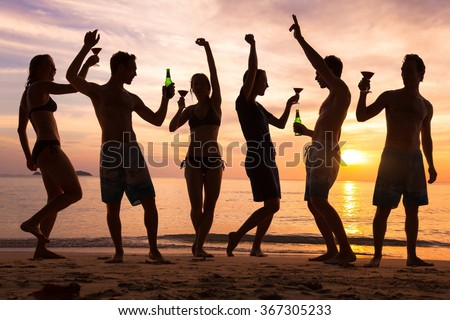 beach party, group of young people dancing, friends drinking beer and cocktails at sunset