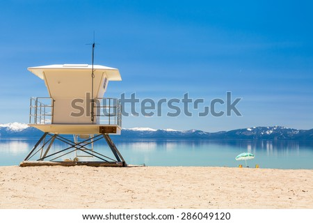 Beach patrol station on the lake against blue sky - stock photo