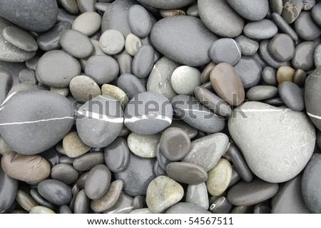 beach pebbles Texture-focus striped stones - stock photo