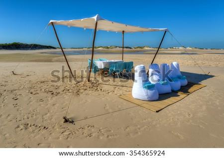 Beach picnic on Bazaruto Island, Mozambique. - stock photo