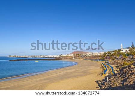 beach promenade of Playa Blanca without people in early morning