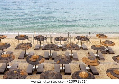 Beach ready for summertime at the island of Mykonos in Greece - stock photo