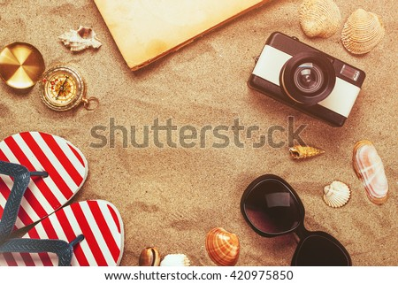Beach ready, summer holiday vacation accessories in sand, objects in flat lay top view arrangement. - stock photo